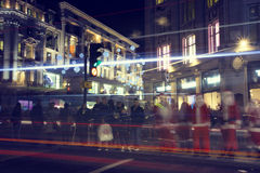 London before Christmas. London, United Kingdom - December 14, 2013: Evening on busy Regent Street in London with Christmas lights and light trails Royalty Free Stock Photo