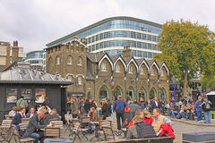 London - CIRCA OCTOBER 2011:. Tower of London. People rest in a historic place on the north bank of the River Thames in central London stock photography
