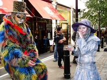 Street performers in fancy dress royalty free stock image