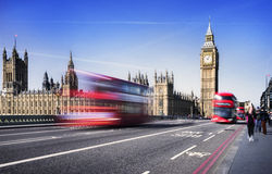 London city by bus. London, the UK. Red bus in motion and Big Ben, the Palace of Westminster. The icons of England in vintage, retro style Stock Images