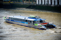 London - City Cruises tour boat sails on the Thames River Stock Photo