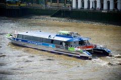 London - City Cruises tour boat sails on the Thames River. LONDON-AUGUST 6: A City Cruises tour boat sails on the Thames River on August 6, 2012 in London Stock Photo