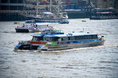 London - City Cruises tour boat sails on the Thames River Stock Image