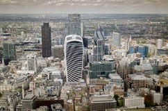 London city financial skyline. Close to River Thames and the Tower of London.  Image cross processed Stock Photography