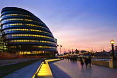 London city hall at night. New London city hall at night with pedestrians on sidewalk Stock Image