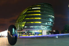 London City hall at night. A colourful photo of London at night with the river Thames Stock Photo