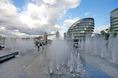 London city hall and tower bridge. A fine example of the blend of ancient and modern architecture in London Stock Photo