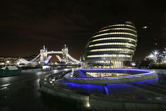 London City Hall and Tower Bridge at Night Royalty Free Stock Image