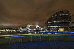 London City Hall and Tower Bridge at night. London City Hall, headquarter of London Authority which comprises the Mayor of London and the London Assembly and Royalty Free Stock Photo