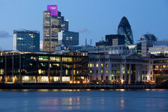 London city illuminated with Olympic rings. London City, leading center of global finance on Thames river bank. View on Tower 42 Gherkin, illuminated with Stock Image