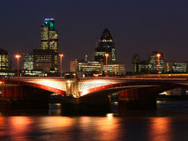 London city - night scene#2. River Thames and London buildings shot at night stock photo