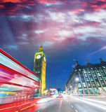 London. City night scene with red bus crossing Westminster. Traf Royalty Free Stock Photography