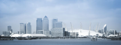 London city o2 arena skyline panorama. City of london financial district skyline and o2 arena millennium dome  seen from the thames river england Royalty Free Stock Photography