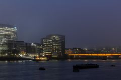 London city and the river Thames panoramic view at night royalty free stock images