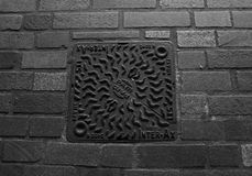 London City Sewer - Pam Pam. A manhole that says PAM-PAM on a cobblestone street in London UK Royalty Free Stock Photo
