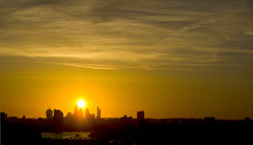 London City Silhouette at Sunset. A wide shot of the sun setting behind Londons Skyscrapers Royalty Free Stock Photos