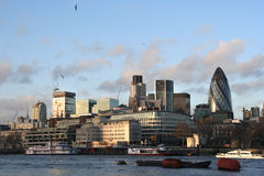 London City Skyline. In the evening from across the Thames royalty free stock image