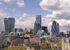 London city skyline. An aerial view of london including the walkie-talkie, the guerkin, the tower of london and other famous buildings with white clouds in the Stock Photography