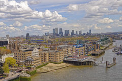 London city skyline. A view of the thames, embankment and the city in the background with white clouds in the sky taken from tower bridge, london, england Stock Photo