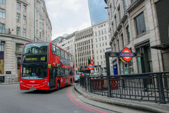 London City Street. Central London city street with iconic double decker bus and subway station entrance Royalty Free Stock Photos