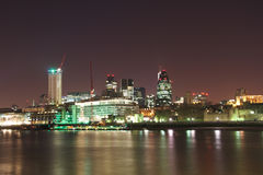 London City Thames bank skyline at night. Night view on the The City business center, taken from the Thames bank, London, United Kingdom Stock Images