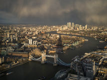 London city about to rain. Tower bridge and canary wharf about to get wet Stock Photo