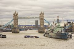 London city with Tower Bridge and HMS Belfast warship for tourists attraction. LONDON, UNITED KINGDOM - FEBRUARY 22 2017: London city with Tower Bridge and HMS Royalty Free Stock Photography