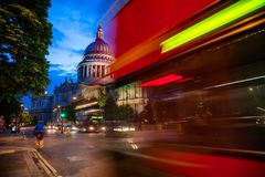 London urban scene with Double Decker bus moves along the St Pau. London cityscape with Double Decker bus moves along the Cannon Street near St Paul`s Cathedral Stock Photo