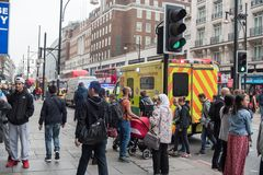 LONDON, ENGLAND - SEPTEMBER 25, 2017: London Cityscape and downtown Oxford Street with people and traffic. Emergency Ambulance. London Cityscape and downtown Royalty Free Stock Image