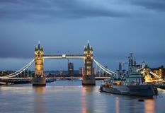 London cityscape with illuminated Tower Bridge and HMS Belfast Stock Image