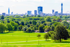 London Cityscape Seen From Primrose Hill. Panoramic view of London cityscape seen from Primrose Hill in Regent's Park on a sunny day Royalty Free Stock Photo