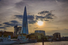 London Cityscape and Shard at sunset HDR. Evening shot of the London city council at the bank of the River Thames with the famous Shard skyscarper in the Stock Photos