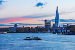 London Cityscape During Sunset. Modern London cityscape during sunset with a pink stripe in sky stock images
