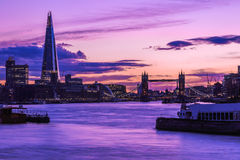 London Cityscape During Sunset. Modern London cityscape during sunset on river Thamse royalty free stock images