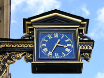 London Clock. Typical City of London buiding clock with blue sky for backdrop Stock Photography