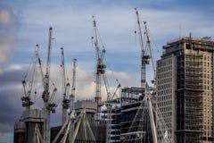London construction craze cranes and skyline. Blue sky royalty free stock photo