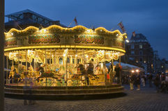 London - Covent Garden. Carousel along Floral Street at dusk Stock Photography