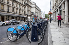 London Cycle Hire. London's self-service cycle Hire. You hire a bike, ride it where you like, and return it to any docking station, ready for the next Stock Photography