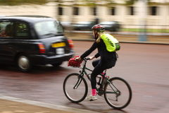 London Cyclist in Motion Royalty Free Stock Photography