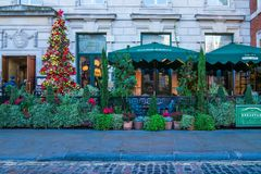 The Ivy Market - restaurant in Covent Garden. LONDON DECEMBER 28, 2017:The Ivy Market Grill on Covent Garden Piazza, one of The Ivy restaurants which offer Royalty Free Stock Images
