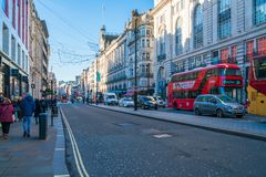 Piccadilly, London UK. LONDON DECEMBER 28, 2017: People and traffic in Piccadilly, known for its video display and neon signs mounted on the corner building as Stock Photography