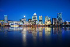 London Docklands at night. London skyscrapers reflected on water at night Stock Photo