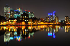 London Docklands at night. London Docklands skyline, illuminated at night with reflections Royalty Free Stock Photo