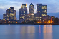 London Docklands night panoramic view. London business district skyline over Thames river at twilight Royalty Free Stock Images