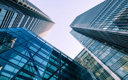 London Docklands skyscrapers. London, UK - 13 May 2015: A low and wide angle view of converging skyscrapers in the business and financial district of London royalty free stock images