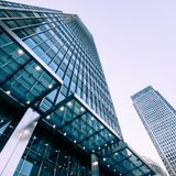 London Docklands skyscrapers. London, UK - 13 May 2015: A low and wide angle view of converging skyscrapers in the business and financial district of London Royalty Free Stock Photos