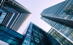 London Docklands skyscrapers. London, UK - 13 May 2015: A low and wide angle view of converging skyscrapers in the business and financial district of London Stock Images