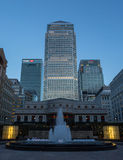 London Docklands view - Canary Wharf HSBC Citi Fountain. Twilight view from the Isle of Dogs, Docklands in a Financial part of London showing central Canary Stock Photos