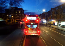 London double decker bus. The rear part of London double decker bus in a street at night Royalty Free Stock Photos