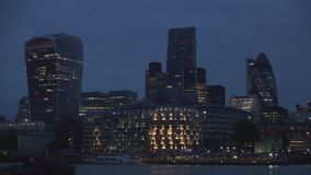 London downtown with office buildings skyscrapers and Thames river in night view.  stock video